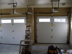 three-car finished garage, 6 ft. walls, extra overhead space, extra large floor area, insulated, dry-walled and painted