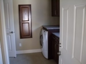main floor laundry room, two appliances, built-in ironing board